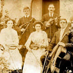 1925. Lerryn School House.  Lerryn String Band. L-R: Evelyn Yeo, Bertram May, Dave Mutton, Mary Collett, Maud Burt, Frank Burt, Percy Bartlett.