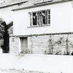 Cobble Cottage, lower road, Lerryn. 1962, before roof extension. Gyp (Gwen's sister) & Tessa Churchill.